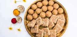 Huldi or turmeric and kumkum or kum kum with tilgul laddu or laddoo in silver bowl, sweet dish in Makar Sankranti festival in hindu religion in India, Indian sweet, isolated on white background